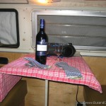 Red wine and table cloth in our Westfalia
