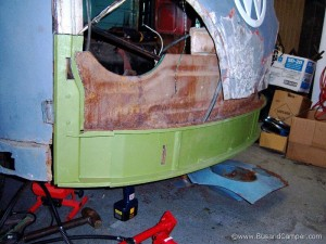 VW green metal repair panels in place on our 65 bus