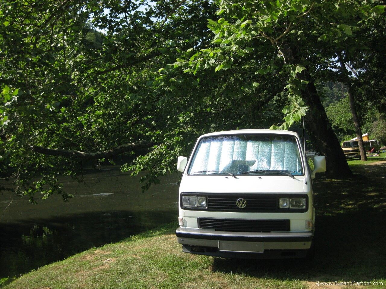 Later White Campervan next to the river