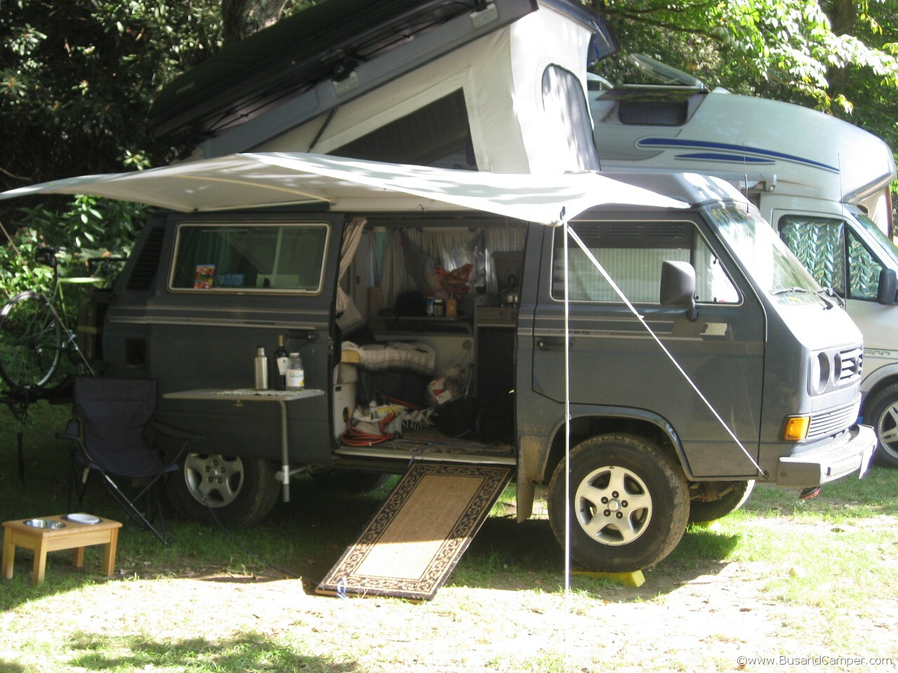 Grey Westy setup and sun shade pop top